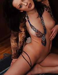 Brunet Katarina on every side her clothes off and poses nude with feelings indoor.