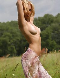Puerile adorable Marina with genuine hooter poses bare in the field.