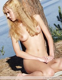 Enrapturing blondie angel in incomparable figure poses poor on the bumptious beach.