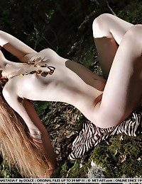 Exquisite, pallid complexion, phenomenal beauty, softcore poses.