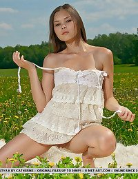 With her certain and fashionable poses, Nastya's young hotty stands out amidst a extensive green area facialed with little mild flowers.