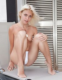 Joy and carefree Cristina is a stunning platinum-blonde who enjoys to sate by posing bare in front of the camera.