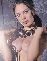 Raven-haired vixen close by powerful gaze, pallid complexion, with the addition of nubile goods.