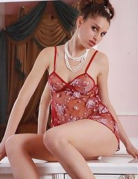 Luxurious nude brown-haired teenager posing entirely nude